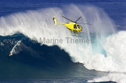 A helicopter filming a tow-in surfer at Peahi (Jaws)